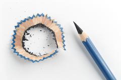 Sharp pencil and shavings - stock photo