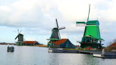 View of Windmills and the river at the Zaanse Schans village Stock Footage