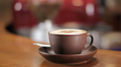 Cup of cappuccino on a bar counter. Focus change - stock footage