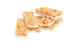 Muesli bars with  dried fruit on isolated background Stock Photos