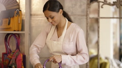 4K Portrait of smiling shopkeeper at work in fashion accessories store Stock Footage