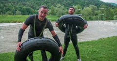 Two men are putting on rubber rings Stock Footage