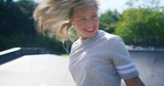 4K Young urban street dancer listening to music through earphones & dancing - stock footage