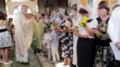 Priest sprinkles holy water Stock Footage