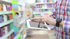 Man Using Phone and Credit Card in Store Stock Footage