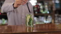 Bartender serves mojito on wooden bar counter Stock Footage
