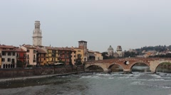 Stone Bridge (Ponte Pietra) and Verona Cathedral Tower Verona Italy Stock Footage
