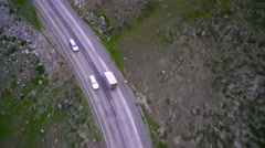 Small truck rises in the pass. Aerial Stock Footage