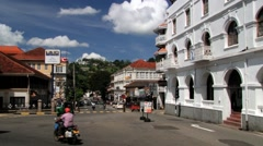 View to the traffic at the street in downtown Kandy, Sri Lanka. Stock Footage