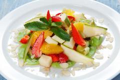 Fruit salad closeup, vegan food Stock Photos