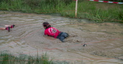 Trying to swim in a mud puddle with water Stock Footage