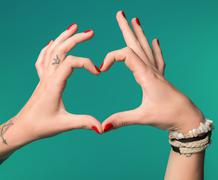 Female hands in the form of heart Stock Photos