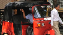 Taxi driver waits for passengers at the street in downtown Kandy, Sri Lanka. Stock Footage