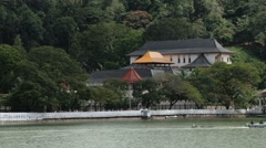 View the Temple of the Tooth with the golden roof of in Kandy, Sri Lanka. Stock Footage