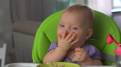 Baby sitting and eats banana Stock Footage