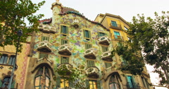 Casa Batllo exterior at sunset. Timelapse House of bones build by Antoni Gaudi Stock Footage