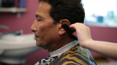 Hairdresser combing customer man brunette - stock footage