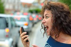 Aghast young woman with a horrified expression - stock photo