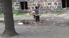 Ghetto in Prerov, Gypsy child playing in a filthy ghetto Stock Footage