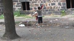 Ghetto in Prerov, Gypsy child playing in a filthy ghetto Arkistovideo