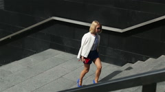 young business woman in short blue trunks up the stairs - stock footage