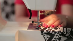 Female hands sewing use the sewing machine, close up Stock Footage