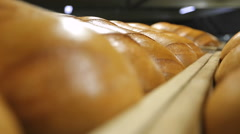 Ruddy freshly baked bread closeup - stock footage
