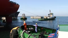 Tugboats Working In The Harbor Stock Footage