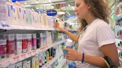 Young Woman Shopping for Cosmetics in Supermarket. - stock footage