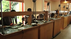 People work in a sapphire jewelry workshop in Kandy, Sri Lanka. Stock Footage