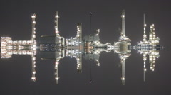 Twilight scene of oil refinery industrial plant with vertical mirror effect Stock Footage