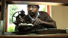 Man works in a sapphire jewelry workshop in Kandy, Sri Lanka. Stock Footage