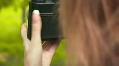 Beautiful young girl takes a picture on the camera. Slow motion - stock footage