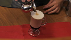 Coffee pouring out. Close up Stock Footage