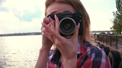 Slim attractive girl takes a picture on retro film camera. Slow motion - stock footage