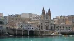 Slima of Malta with church view - slow motion follow focus Stock Footage