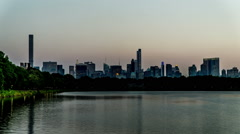 Timelapse of the Central Park and modern buildings looking Stock Footage
