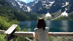 Woman admire amazing view of mountains and lake, super slow motion 240fps Stock Footage