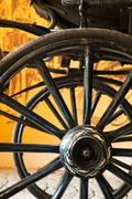 Close up view of carriage wheels with long spokes Stock Photos