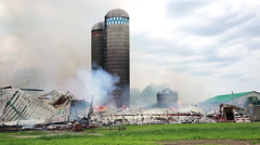 Firefighters battle silo and barn fire. Stock Footage