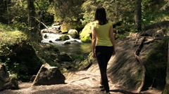 Woman trekking in forest and admire amazing view of river, super slow motion 240 Stock Footage