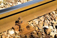 Close up detail of a rail track - stock photo