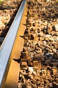 Close up view of steel railroad track - stock photo