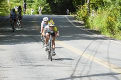Riders zipping downhill Stock Photos