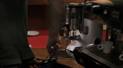Barista tamping portion of ground coffee beans. Medium shot Stock Footage