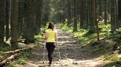 Young woman hiking in forest, super slow motion 240fps Stock Footage