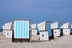 roofed wicker beach chairs - stock photo