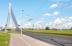 Suspension bridge on the river Daugava of Riga. - stock photo
