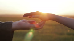 hand mom and baby at sunset - stock footage