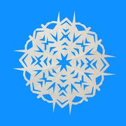 Paper white snowflake lie on blue background - stock photo